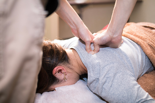 woman receiving Medical Massage therapy near me for Insurance Massage